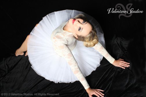 Beautiful woman shows off her gorgeous looks at her boudoir photo shoot at Valentine Studios in San Diego, CA.