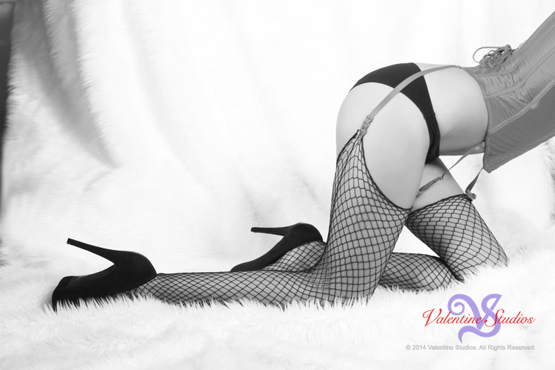 This gorgeous blonde looks stunning in her boudoir photo shoot at Valentine Studios.
