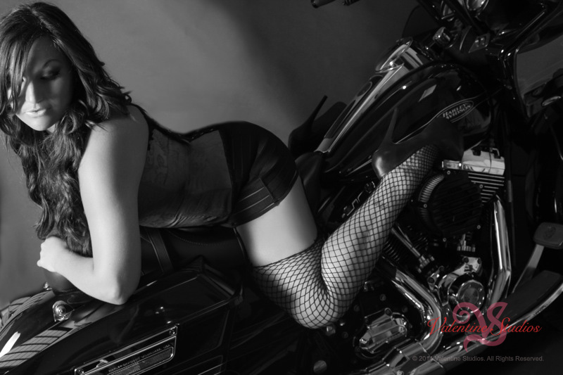 Valentine Studios boudoir photo of a beautiful woman having fun with sexy poses on her motorcycle.