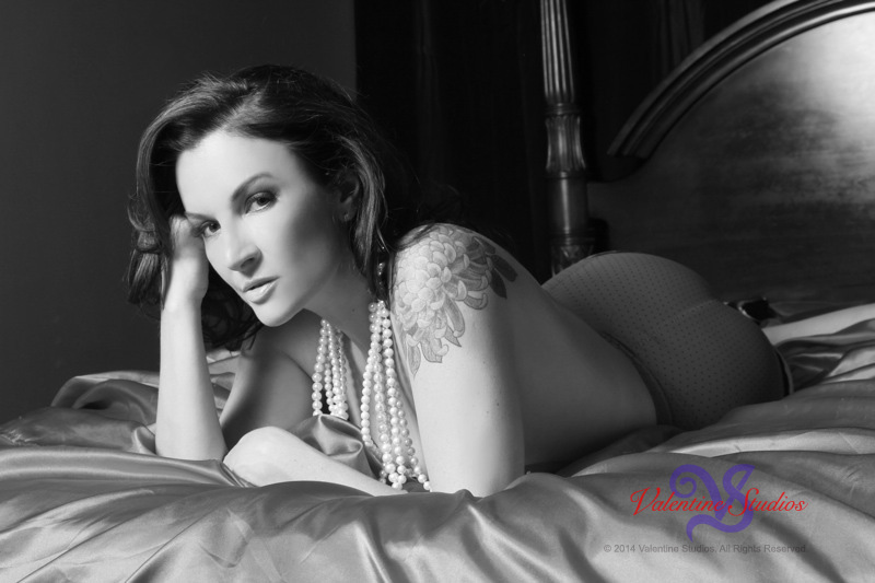 This beautiful woman looks fabulous draped in pearls during her boudoir photo shoot.