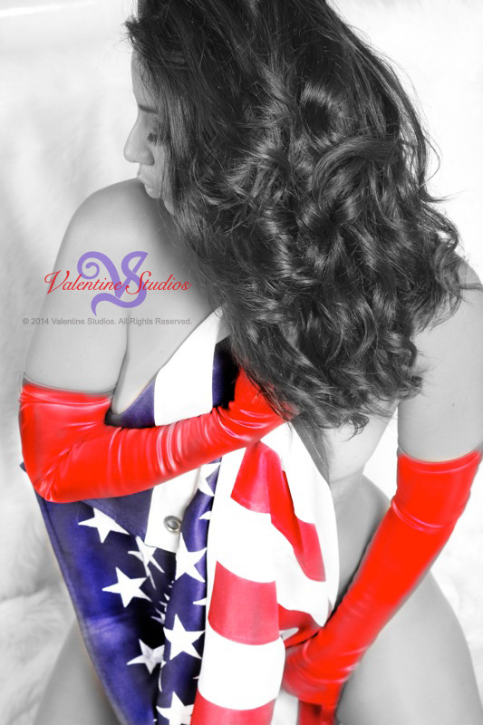 This beautiful woman shows her patriotic love of America at her boudoir photo shoot.