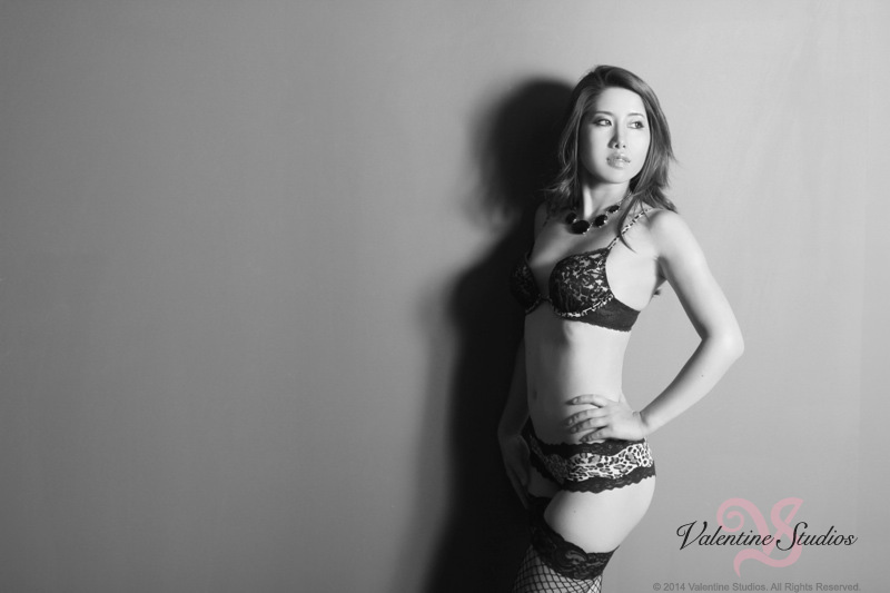 This beautiful woman looks gorgeous in leopard print lingerie at her boudoir photo shoot at Valentine Studios.
