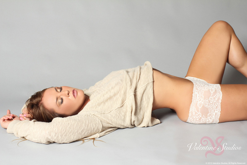 Relaxed, glamorous and stunning in your boudoir photo shoot from Valentine Studios.