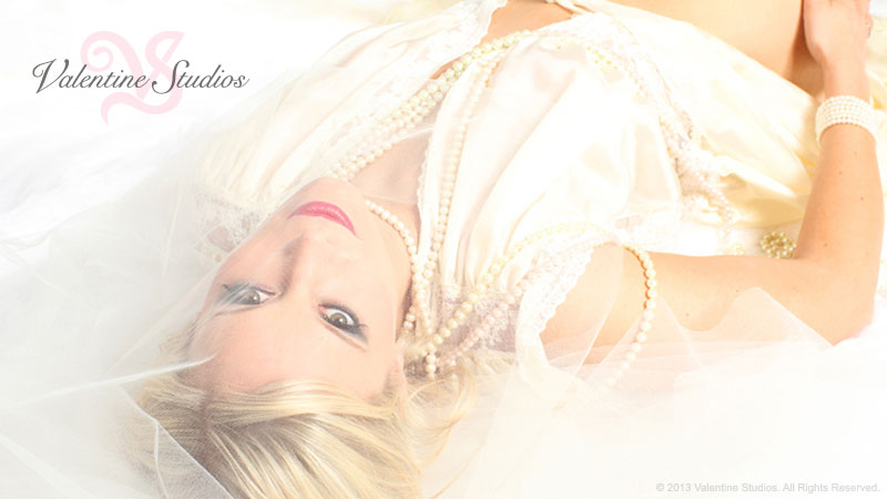 The best wedding night gift, besides yourself, is a beautiful bride boudoir photo shoot. Valentine Studios in San Diego, CA.