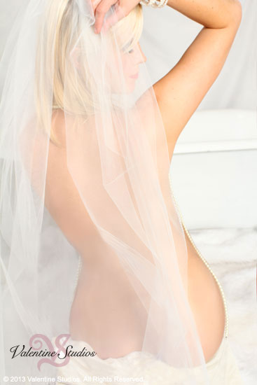 Be a veiled female goddess in your bridal boudoir photo shoot at Valentine Studios.