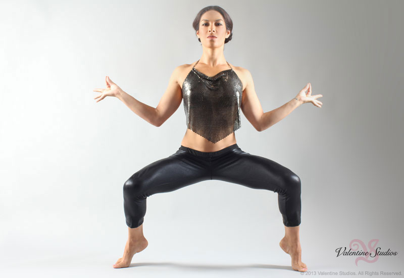 Horse racing jockey Kayla Stra poses for her Santa Anita Hot Yoga Studio advertising photos.